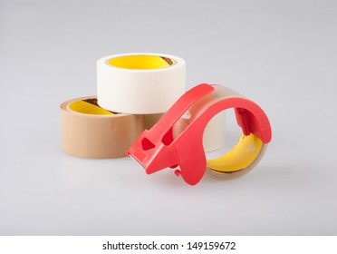 Adhesive tapes and cutter holder dispenser best for wrapping box or others, the image isolated