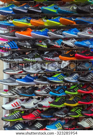 778d60deb Adidas Shoes In Shoe Store Display and of Nike sport shoes. New unbranded running  shoe