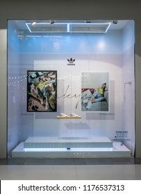 Adidas shop at Central Westgate Bangkok, Thailand, May 10, 2018 : Fashionable sportswear brand visual merchandising. Modern white design window display.