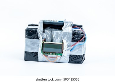 adio-controlled bomb with lcd screen, cell phone and colored wires on a white background. Concept image of terrorism, Explosion