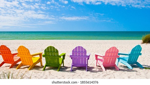 Adirondack Beach Chairs On A Sun Beach In Front Of A Holiday Vacation Travel House.