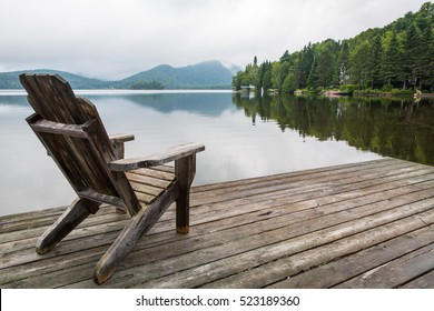 Adirondack chair on lake dock
