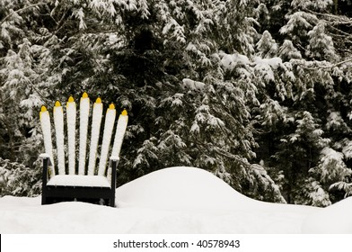 Adirondack chair in snow in Vermont against evergreen trees
