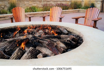 Adirondack chairs by the fire pit