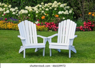 Adirondack Chairs in the flower Garden on Mackinac Island, Michigan, USA