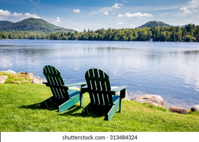 Adirondack chairs. Mirror Lake, Lake Placid New York. Summer, vacation, outdoors, travel, explore, nature, camping, lake and mountain vacation concept - Shutterstock ID 313484324