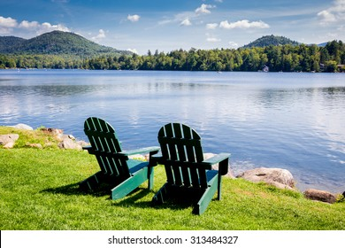 Adirondack chairs. Mirror Lake, Lake Placid New York. Summer, vacation, outdoors, travel, explore, nature, camping, lake and mountain vacation concept - Shutterstock ID 313484327