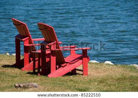 Adirondack chairs on beach Beach Adirondack Chairs On Beach Shutterstock Adirondack Chairs On Beach Stock Photo edit Now 85222510