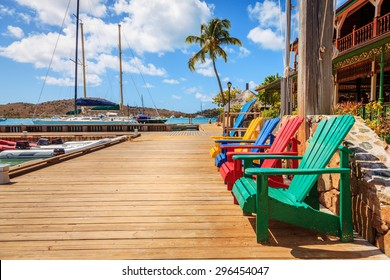 Adirondack chairs on a dock on Virgin Gorda Island, BVI