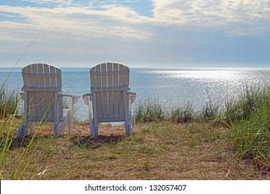 Adirondack chairs on the shore of Lake Michigan at Blue Harbor Resort in Sheboygan, WI.