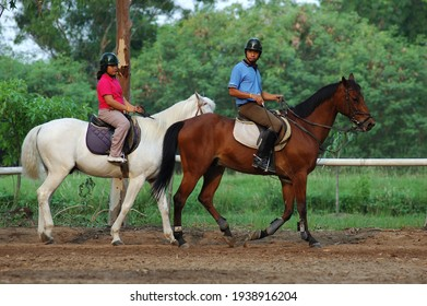 Adisorn Military Camp, Saraburi Province, Thailand, 12 May 2013 : The tourists in happy moment with their horse riding activity as adventure tourism in Thai Army Camp, central region.