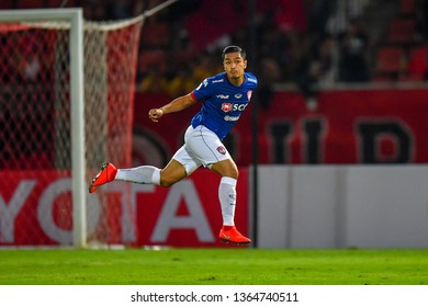 Adisorn Promrak (Blue)of SCG Muangthong United in action during The Football Thai League between Bangkok United and SCG Muangthong United at True Stadium on March 02,2019 in Pathum Thani, Thailand