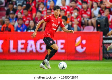 Adisorn Promrak no.11(red)of SCG Muangthong United in action during The Football Thai League between SCG Muangthong United and PT Prachuap F.C.at SCG Stadium on February24,2019 in Nonthaburi, Thailand