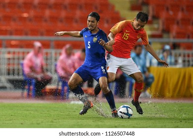 Adisorn Promrak No.5 (blue) of Thailand in action during 2018The International Friendly Match between Thailand and China at the Rajamangala Stadium on June 2, 2018 in Bangkok,Thailand,