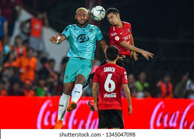 Adisorn Promrak (R)of SCG Muangthong United in action during The Football Thai League match between SCG Muangthong United and PT Prachuap F.C.at SCG Stadium on February24,2019 in Nonthaburi,Thailand