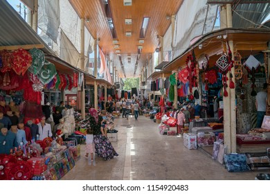 Adiyaman, Turkey - July 2018: Unidentified people shopping in Adiyaman city historical old Oturakci bazaar inside the old city, Turkey