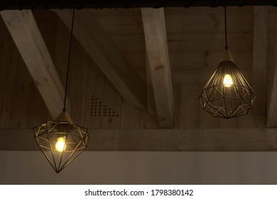 adjacent lamps hanging from the ceiling