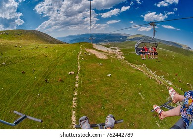 ADJARA REGION, GEORGIA - 08 August 2017: Happy tourists riding ropeway in Georgian Adjara region