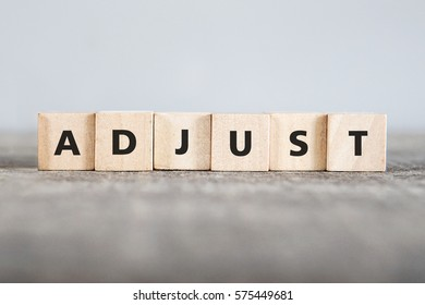 ADJUST word made with building blocks