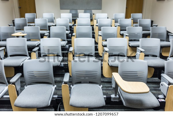 Adjustable desk seats in lecture hall or classroom, university, college, library, office, hospital