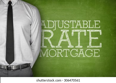 Adjustable rate mortgage text on blackboard with businessman on side