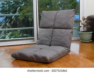 Adjustable sofa seat on the wooden floor in the living room
