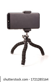 Adjustable universal smart phone tripod for remote recording and podcast isolated on the white background
