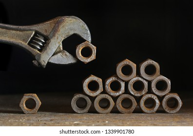 Adjustable wrench is building tower from nuts