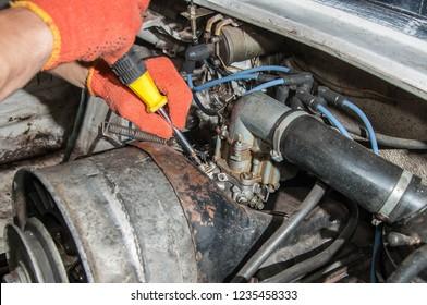 Adjusting the carburetor of an old car