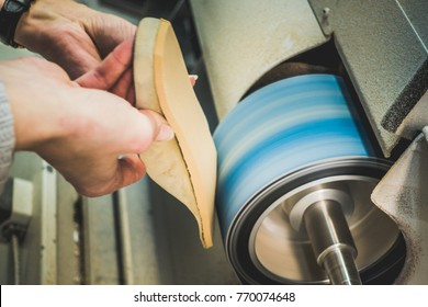 Adjusting an Orthotics Sole by Sanding it in a Workshop