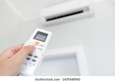 Adjusting temperature of air conditioner by remote. Air conditioning system