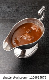 adle Beef curry into a gravy boat