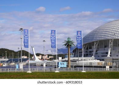 """Adler, Russia - November 1, 2016: Flags with the inscription """"Welcome to Sochi"""" near the stadium Fisht in Adler, Russia"""