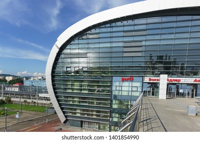 "Adler, Sochi, Russia - may 05, 2019: View of the southern facade of the modern passenger railway station. Sunny day in late spring. The inscription in Russian ""Adler Station"""