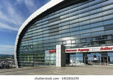 "Adler, Sochi, Russia - may 05, 2019: the southern facade of the new modern passenger railway station. The inscription in Russian ""Adler Station"""