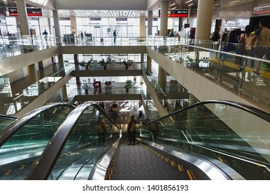 Adler, Sochi, Russia - may 05, 2019: the Descent on the escalator to the exit from the fourth floor of the modern passenger railway station. Lots of glass and sunlight