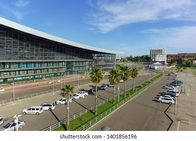 Adler, Sochi, Russia - may 05, 2019: View of the city and the sea from the stairs of the modern passenger railway station. Palm trees are fixed with ropes because of the strong wind in the open