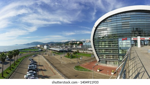 "Adler, Sochi, Russia - may 05, 2019: Landscape view of the city and the sea from the stairs of the modern passenger railway station. Sunny day. The inscription in Russian ""Adler Station"""