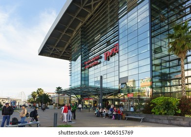 Adler, Sochi, Russia - may 05, 2019: Passengers near the Northern entrance to the railway station. Warm spring evening