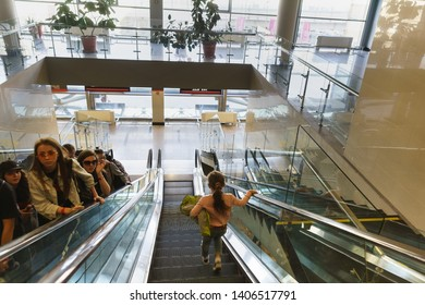 Adler, Sochi, Russia - may 05, 2019: People on escalators in the new modern railway station. Travelers climb with comfort
