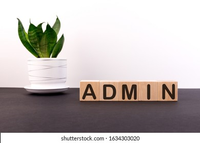 ADMIN word built with letter cubes on a black table