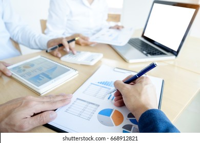 Administrator business man financial inspector and secretary making report, calculating or checking balance. Internal Revenue Service inspector checking document. Audit finance concept.