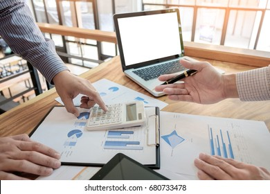 Administrator business man financial inspector and secretary making report, calculating or checking balance. Internal Revenue Service check document. Audit concept.