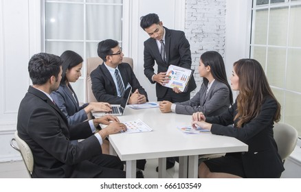 Administrator  business Meeting financial inspector and secretary making report, calculating or checking balance. Internal Revenue Service inspector checking document.