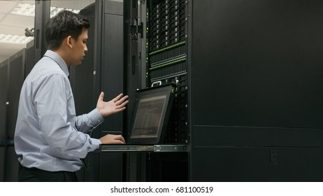 Administrator serious working in data center