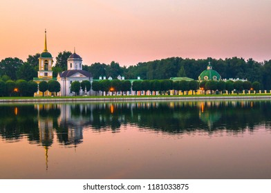 Admirable pink sunset sky over the architectural ensemble of the State reserve museum Kuskovo, former aristocratic summer country estate of the russian nobility of the 18th century. Moscow. Russia.