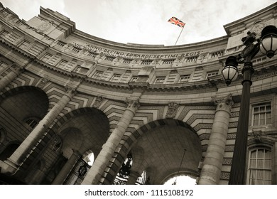 Admiralty Arch over dramatic sky, designed by Sir Aston Webb, completed in 1912,  located between The Mall and Trafalgar Square.
