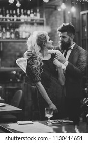 admirer. Business meeting of man and woman. Couple in love meet at restaurant. Valentines day with sexy woman and bearded man. Date of family couple in romantic relations, love.