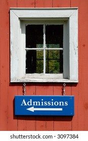 Admission sign hanging from a window of an old building