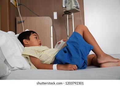 An admitted sick kid in the hospital with Sodium Chloride solution for intravenous drip